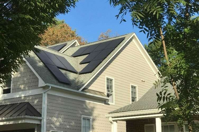 house with solar panels funded by clean energy advantage